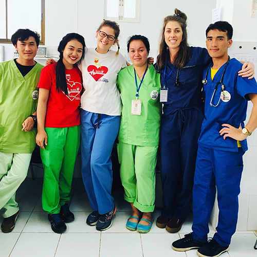 Six pediatric residents in a line with their arms around each others' shoulders.