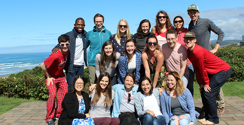 The PGY-2 Pediatric Residency Class outside with the ocean in the background.
