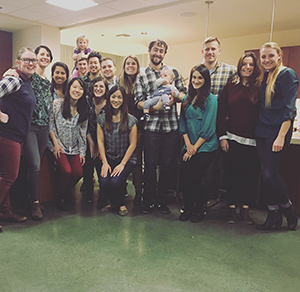 A group of OHSU Pediatric Residents posing after a friends Thanksgiving dinner.