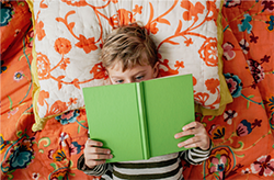 Stock photo of a child reading a book