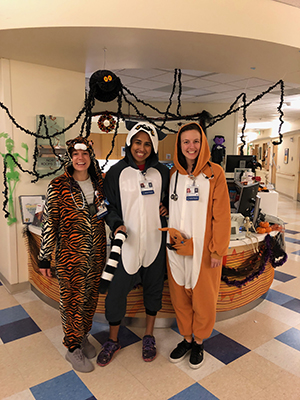 Three OHSU Pediatric Residents dressed in Halloween costumes in clinic.
