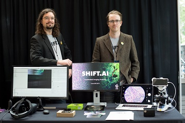Geoff and Erik with their Shift.AI prototype booth