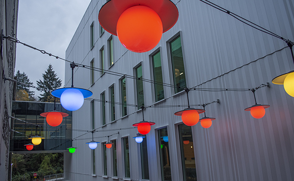 A view of the multicolored lights above the outdoor courtyard of the Elks Children's Eye Clinic building.