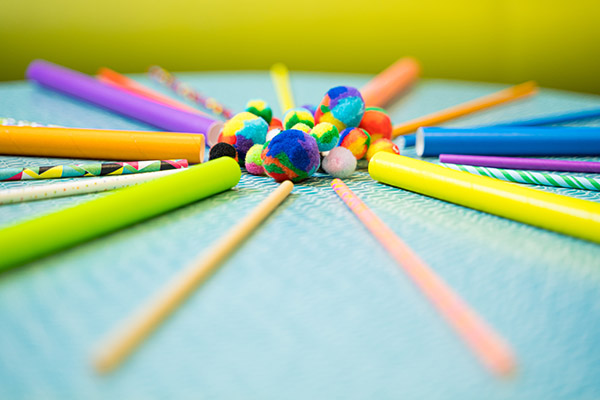 Photo of straws and fuzzy pompoms arranged in a circle