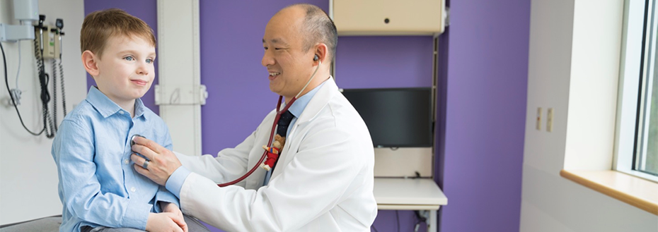 Pedatrician Dr. Derek Lam examines a young patient at Doernbecher Children's Hospital